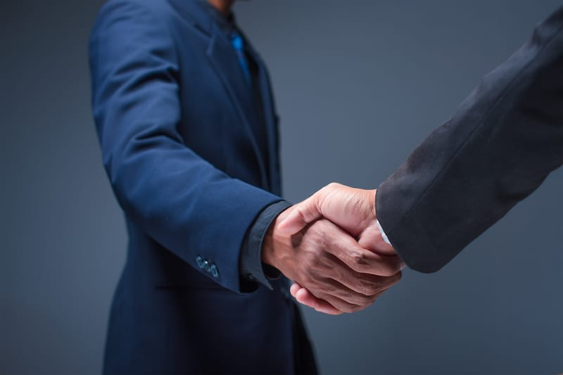 business people shake hands office - Health and Safety